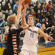 Hoggard's Jack Bagley shoots over New Hanover's Brian Howell Friday December 12, 2014 at Hoggard High School in Wilmington, N.C. (Jason A. Frizzelle)