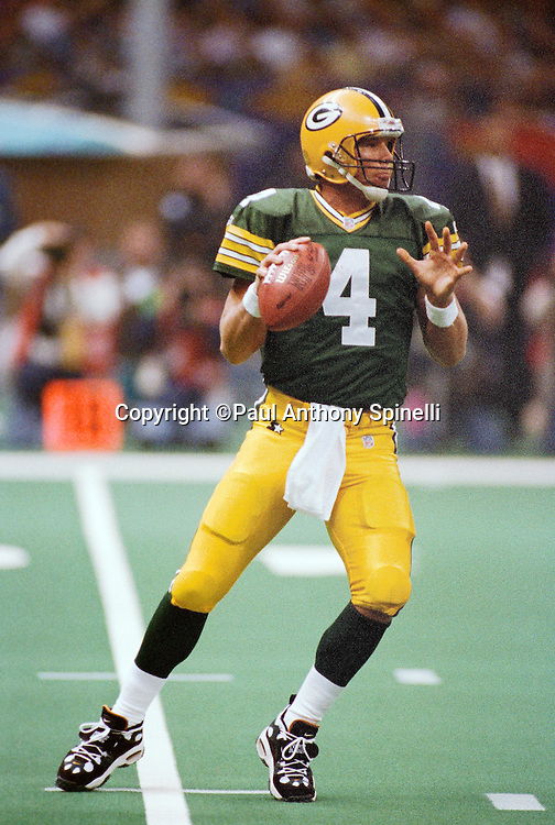 Green Bay Packers quarterback Brett Favre (4) drops back to pass during the NFL Super Bowl XXXI football game against the New England Patriots on Jan. 26, 1997 in New Orleans. The Packers won the game 35-21. (©Paul Anthony Spinelli)