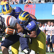 Bucknell safety Matthew Steinbeck (26) is tackled by Delaware Cornerback Tim Breaker (3) and Delaware Linebacker Jeff Williams #57 which led to Steinbeck fumbling the ball during a Week 3 NCAA football game against Delaware...#13 Delaware defeated The Bison of Bucknell 19 - 3 at Delaware Stadium Saturday Sept. 15, 2012 in Newark Delaware..