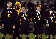 "20 NOV. 2010 -- FENTON, Mo. -- St. John Vianney High School ""B"" team soccer coach Tim Hantak (second from left) consoles several Vianney players after the Golden Griffins lost to Rockhurst 3-1 in the MSHSAA Class 3 soccer championship game at the Anheuser-Busch Center in Fenton, Mo. Saturday, Nov. 20, 2010. Among those Hantak spoke with privately included Josh Hubert (11), Jason Grant (10), Paul Scheipeter (9) and Tim Varnum (8).  Image © copyright 2010 Sid Hastings."
