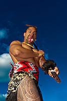 A Maori warrior with a ta moko (facial tattoo) performs a war haka (dance), Te Puia (New Zealand Maori Arts & Crafts Institute), Rotorua, New Zealand