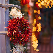 Festive chile wreaths and holiday Christmas lights decorate Old Town Albuquerque, New Mexico.