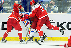 Sergei Plotnikov of Russia between Jesper Jensen of Denmark and Oliver Lauridsen of Denmark  during Ice Hockey match between Russia and Denmark at Day 6 in Group B of 2015 IIHF World Championship, on May 6, 2015 in CEZ Arena, Ostrava, Czech Republic. Photo by Vid Ponikvar / Sportida