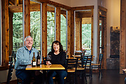 Dennis and Marlene Grant owners and winemaker for Parrot Mountain Cellars in their tasting room.
