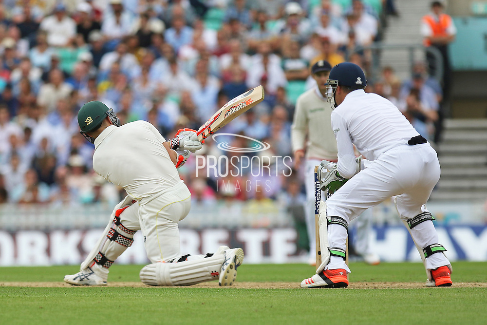 David Warner of Australia hits a boundary during the 1st day of the 5th Investec Ashes Test match between England and Australia at The Oval, London, United Kingdom on 20 August 2015. Photo by Phil Duncan.