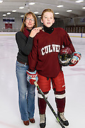 Teri Weiss, mother and inventor of Skate Armor laceration-protective neckwear, is pictured with her son, Mason, 14, at the Verona Ice Arena in Verona, Wis., on Sept. 30, 2015. Weiss's product, Skate Armor, is a cut-resistant neck wrap intended to cover and protect the human body's vital neck arteries from potential abrasions and cuts from the blades of hockey skates. (Photo by Jeff Miller, www.jeffmillerphotography.com)