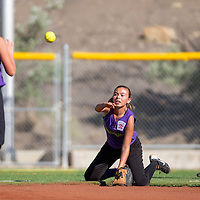 070113       Cable Hoover<br /> <br /> Grants Dynamite Justine Otero (4) drops to her knees to scoop the ball to teammate Josephine Bustos (9) during the district tournament Monday at Ford Canyon Park in Gallup.