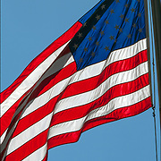 American Flag blowing in the wind, symbol of United States of America, freedom, pride, loyalty and patriotism. The stars and strips, the red white and blue.