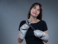 one caucasian woman thinking holding kitchen utensils isolated studio on grey background