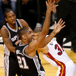 Jun 20, 2013; Miami, FL, USA; San Antonio Spurs power forward Tim Duncan (21) shoots against the Miami Heat during the first quarter of game seven in the 2013 NBA Finals at American Airlines Arena. Mandatory Credit: Derick E. Hingle-USA TODAY Sports