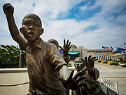 08 JUNE 2018 - SEOUL, SOUTH KOREA:  A detail of a statue of civilian refugees in the Korean War at the War Memorial of Korea in Seoul, South Korea. The museum is in the background. With the near constant threat of invasion from North Korea, many South Koreans take great pride in the ability of their armed forces. Some observers believe there is a possibility that a peace agreement between South and North Korea could be signed following the Trump/Kim summit in Singapore. The War Memorial and museum opened in 1994 on the former site of the army headquarters to exhibit and memorialize the military history of Korea. When it opened in 1994 it was the largest building of its kind in the world. The museum features displays about the Korean War and many static displays of military equipment.   PHOTO BY JACK KURTZ