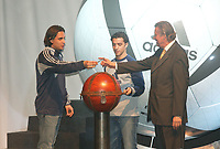 LISBOA-29 NOVEMBRO 2003:NUNO GOMES, player of S.L.Benfica delivers the key that opens the Adidas Roteiro vault to GERAHARD AIGNER executive director of UEFA 29/11/2003, in the photo from left to rigth GILBERTO MADAIL (President of the EURO 2004),NUNO GOMES (S.L.Benfica), SIMÃO SABROSA (S.L.Benfica) and GERAHARD AIGNER (E.D. UEFA); ADIDAS presents the official ball for the EURO 2004 in FILL auditorium-Lisbon<br />