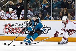 February 1, 2011; San Jose, CA, USA; San Jose Sharks right wing Dany Heatley (15) skates with the puck past Phoenix Coyotes right wing Scottie Upshall (8) during the first period at HP Pavilion. Mandatory Credit: Jason O. Watson / US PRESSWIRE