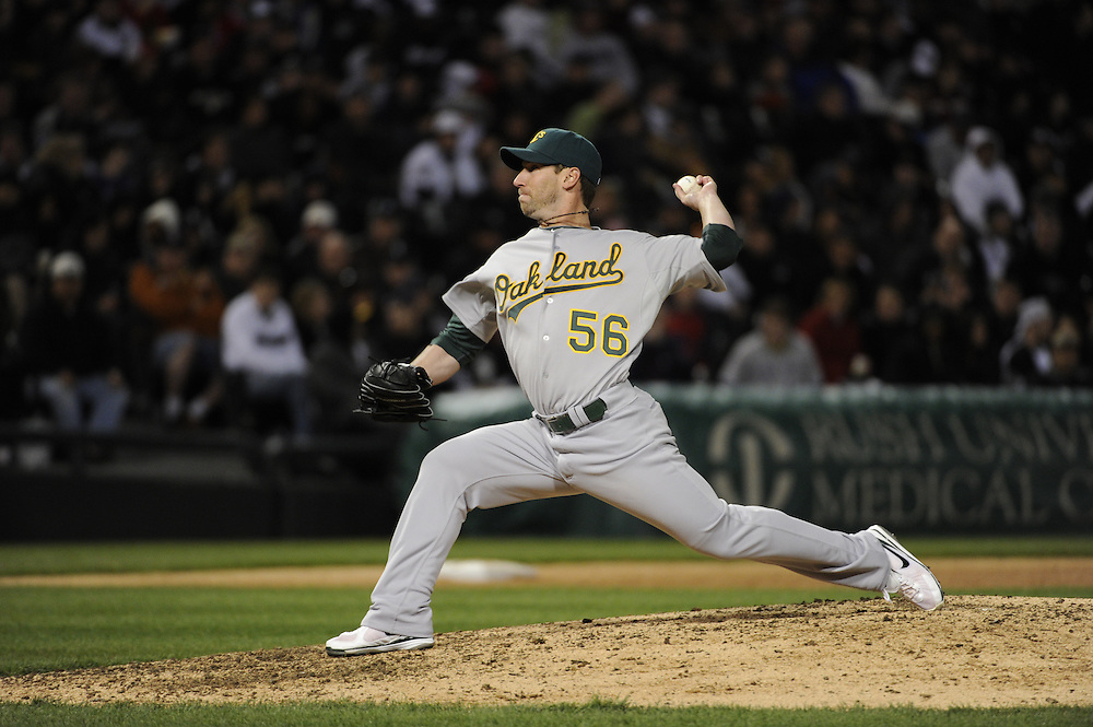 CHICAGO - APRIL 12:  Craig Breslo #56 of the Oakland Athletics pitches against the Chicago White Sox on April 12, 2011 at U.S. Cellular Field in Chicago, Illinois.  The White Sox defeated the Athletics 6-5.  (Photo by Ron Vesely)  Subject:  Craig Breslo
