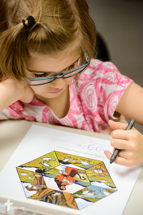 A young girl reads materials during the Camp Courage VBS at Zion Lutheran Church on Thursday, July 13, 2017, in Ottawa, Ill. The VBS resource is available from LCMS Disaster Response.  LCMS Communications/Erik M. Lunsford
