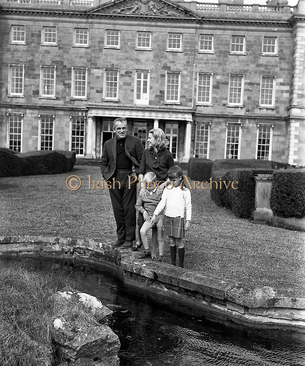 26/08/1963<br /> 08/26/1963<br /> 26 August 1963<br /> Royal Visit by Prince Rainier and Princess Grace of Monaco. Prince Rainier and Princess Grace and their two children, Prince Albert (5) and Princess Caroline (7) settling in at Carton House, Maynooth, Co. Kildare as they start their holiday. Picture shows The Royal family looking for goldfish in the pond of Carton House, their Irish holiday home for three weeks.