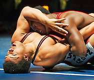 Beau Breske of Hartford, Wis., fights for position against Kamal Bey during the 170-pound cadet freestyle national title match Friday, July 25, 2014, at the Fargodome in Fargo, N.D.<br /> Nick Wagner / The Forum