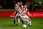 Ben Whiteman of Doncaster Rovers, Tommy Rowe of Doncaster Rovers, Barnsley midfielder Kenny Dougall (4) and Andrew Butler of Doncaster Rovers watch the ball during the EFL Sky Bet League 1 match between Doncaster Rovers and Barnsley at the Keepmoat Stadium, Doncaster, England on 15 March 2019.