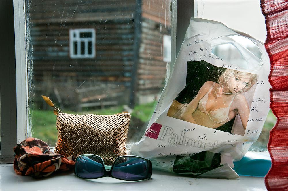 A women's belongings sit on a windowsill in Siberia