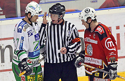 Nik Zupancic of Olimpija, referee and Dejan Varl of Jesenice after a fight at ice hockey match Acroni Jesencie vs ZM Olimpija in second round of final of Slovenian National Championship,  on April 5, 2008 in Arena Podmezaklja, Jesenice, Slovenia. Acroni Jesenice won the game 6:1 and lead the series 2:0.  (Photo by Vid Ponikvar / Sportal Images)