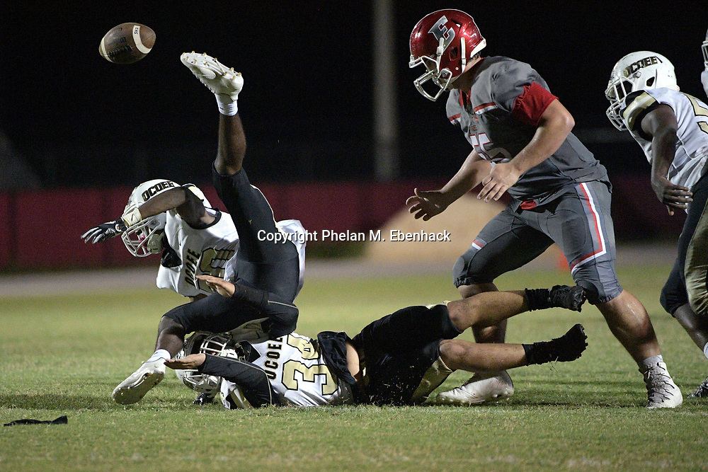 Ocoee's Javon Cox (20) loses control of the ball after colliding with Alex Suarez (34), while trying to recover a fumble by Edgewater quarterback Robert Harvey Jr. during the second half of a high school football game Monday, Oct. 9, 2017, in Orlando, Fla. Edgewater retained possession of the ball. And Edgewater won 44-29. (Photo by Phelan M. Ebenhack)