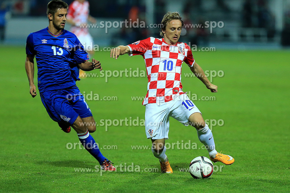 13.10.2014, Stadion Gradski vrt, Osijek, CRO, UEFA Euro Qualifikation, Kroatien vs Aserbaidschan, Gruppe H, im Bild Dmitri Nazarov, Luka Modric // during the UEFA EURO 2016 Qualifier group H match between Croatia and Azerbaijan at the Stadion Gradski vrt in Osijek, Croatia on 2014/10/13. EXPA Pictures &copy; 2014, PhotoCredit: EXPA/ Pixsell/ Davor Javorovic<br /> <br /> *****ATTENTION - for AUT, SLO, SUI, SWE, ITA, FRA only*****
