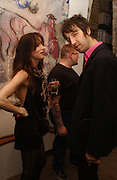 Juliette Lewis and  Joseph Arthur ( pink shirt)  at the private view for artist Joseph Arthur's   exhibition at the Vertigo Gallery, Gt. Eastern St.  on February 9 2006. ONE TIME USE ONLY - DO NOT ARCHIVE  © Copyright Photograph by Dafydd Jones 66 Stockwell Park Rd. London SW9 0DA Tel 020 7733 0108 www.dafjones.com