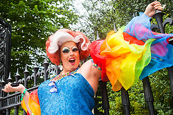 London, July 8th 2017. Thousands of LGBT+ revellers take part in the annual Pride in London parade under the banner #LoveHappensHere. PICTURED: An early-arriving drag queen poses for the first of what will be many hundreds of pictures.