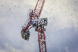 © Licensed to London News Pictures. 15/01/2018. London, UK. Carillion cranes on a construction site in central London. The construction firm has gone into liquidation after losing money on big contracts and running up debts of around £1.5bn. Photo credit: Rob Pinney/LNP