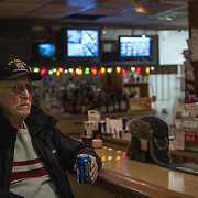 TAKOMA PARK, MD  - JAN 25: Retired Air Force veteran Bob Beers and volunteer bartender, drinks a beer at his local VFW post in Takoma Park, Maryland, January 25, 2014. VFW Posts are dying all across the country but in the unlikely liberal haven of Takoma Park, the old VFW is showing signs of life. By throwing open the doors to private parties and concerts, the club is breaking even in spite of dwindling membership. Several times a month, the bar dwelling regular vets are sharing space with the bureaucrats, activists and peaceniks from the surrounding neighborhood. (Photo by Evelyn Hockstein/For The Washington Post)