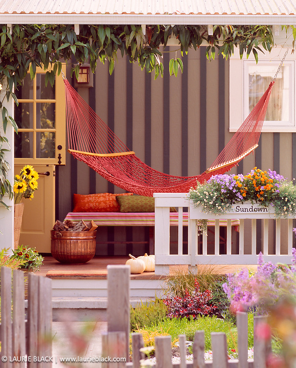 Inviting hammock on cottage porch.