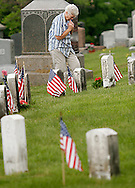 Myrtle Salonich of Liberty stands in  the veterns section of Liberty Cemetery after placing flowers at the grave of her brother Albert W. Lippelt on Memorial Day, May 28, 2007. Pfc. Lippert was killed on Aug. 18, 1944, in France.