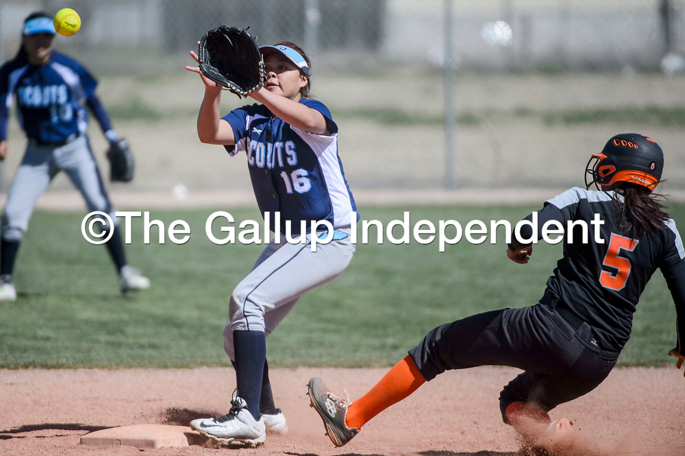 Window Rock Scout Sonja Ayze (16) reaches for the ball as Gallup Bengal LeiLani Yermen (5) slides into second Tuesday at Gallup High School.
