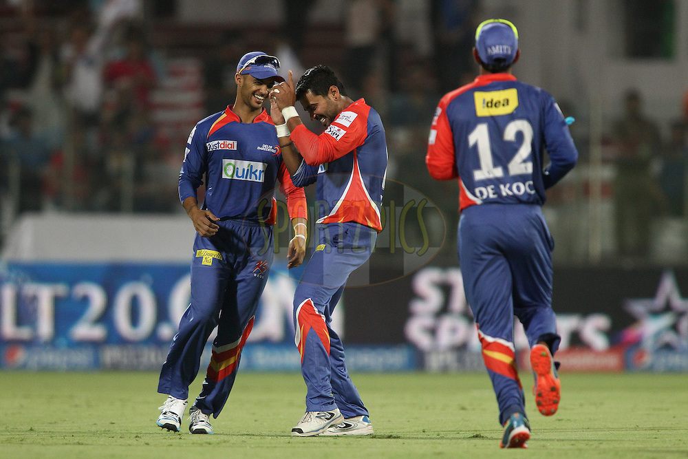 Murali Vijay of the Delhi Daredevils celebrates taking the catch to get Ajinkya Rahane of the Rajasthan Royals wicket as Jean-Paul Duminy of the Delhi Daredevils congratulates him during match 23 of the Pepsi Indian Premier League Season 2014 between the Delhi Daredevils and the Rajasthan Royals held at the Feroze Shah Kotla cricket stadium, Delhi, India on the 3rd May  2014<br /> <br /> Photo by Shaun Roy / IPL / SPORTZPICS<br /> <br /> <br /> <br /> Image use subject to terms and conditions which can be found here:  http://sportzpics.photoshelter.com/gallery/Pepsi-IPL-Image-terms-and-conditions/G00004VW1IVJ.gB0/C0000TScjhBM6ikg