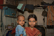 Jiannatnisha Shaikh with her son Sanua Shaikh in her home by the Bandra Station, Mumbai, India