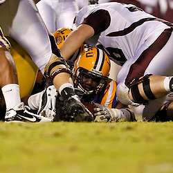 November 13, 2010; Baton Rouge, LA, USA; LSU Tigers defensive tackle Lazarius Levingston (95) recovers a fumble against the Louisiana Monroe Warhawks during the first half at Tiger Stadium.  Mandatory Credit: Derick E. Hingle
