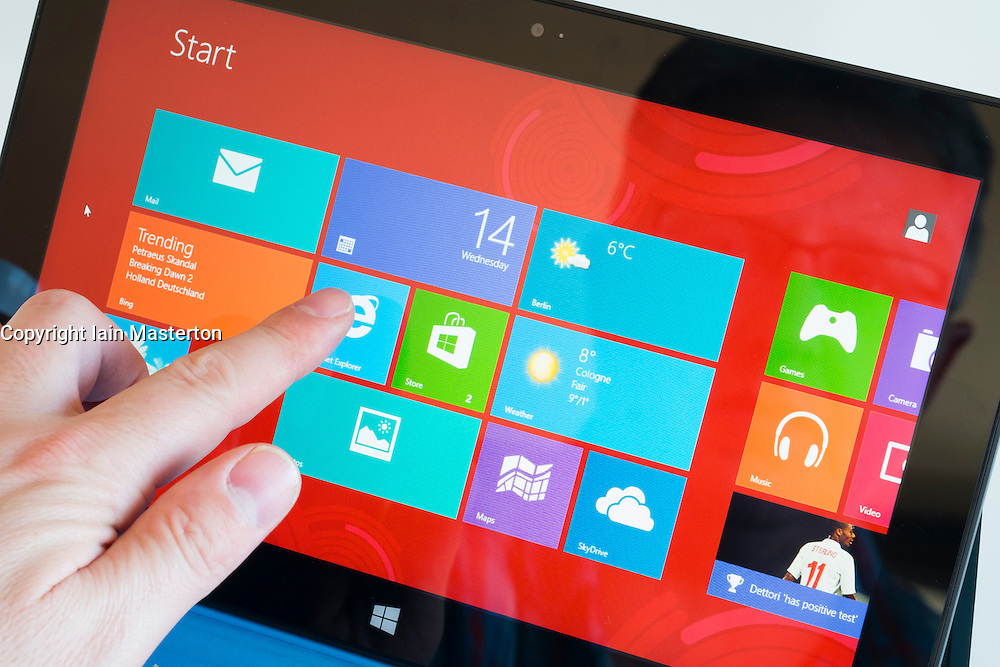 detail of man using homescreen of Microsoft Surface rt tablet computer