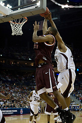 Virginia Tech Hokies forward Lewis Witcher (21) has a shot blocked by Southern Illinois Salukis forward Randal Falker (14).  The #4 seed Southern Illinois Salukis defeated the #5 seed Virginia Tech Hokies 63-48 in the second round of the Men's NCAA Basketball Tournament at the Nationwide Arena in Columbus, OH on March 18, 2007.