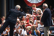 President Bill Clinton shakes hands with school children during a campaign stop for his re-election August 27, 1996 in Wayandotte, MI
