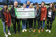Forest Green Rovers Ladies receive a cheque from the Supporters Club during the EFL Sky Bet League 2 match between Forest Green Rovers and Scunthorpe United at the New Lawn, Forest Green, United Kingdom on 7 December 2019.