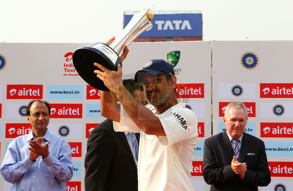 MS Dhoni of India with the series trophy during day 3 of the 4th Test Match between India and Australia held at the Feroz Shah Kotla stadium in Delhi on the 24th March 2013..Photo by Ron Gaunt/BCCI/SPORTZPICS ..Use of this image is subject to the terms and conditions as outlined by the BCCI. These terms can be found by following this link:..http://www.sportzpics.co.za/image/I0000SoRagM2cIEc