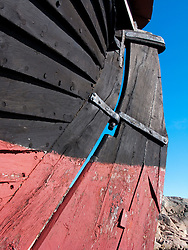 Detail of hull of old wooden fishing boat on shore on Swedens western Bohuslan coast 2009