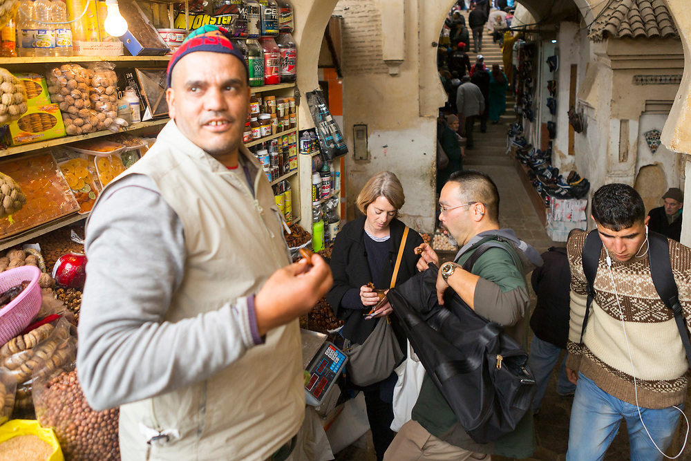 Fez, Morocco - 5th MARCH 2016 - Tourists shopping at a market stall in the old Fez Medina, Middle Atlas Mountains, Morocco.