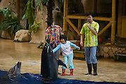 Beijing Aquarium. Sea lion and dolphin show. Greeting a young visitor.