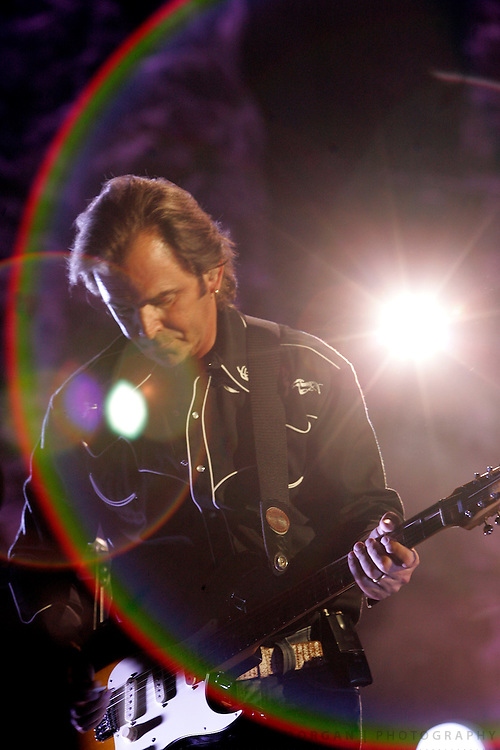 SCOTT MORGAN | ROCKFORD REGISTER STAR.Jonathan Cain plays guitar while performing with Journey Tuesday, Aug. 18, 2009, while on the Don't Stop Believin' tour with Heart at the MetroCentre in Rockford.