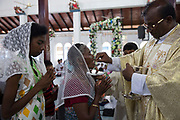 Members of the Afro-Sri Lankan community attend Sunday Mass at St Mary's Church on the event of the 500 year celebration held on September 24th. The date of the event was decided by them and roughly relates to the time they believe the first African slaves were brought to the Island by the Portuguese at the beginning of the 16th Century.<br /> <br /> Out of all communities of African diaspora that surround the Indian Ocean those of Sri Lanka are by far the smallest and most fragile, first brought by the Portuguese, the Dutch and eventually the British as slaves.<br /> <br /> After the Abolition of the Slave Trade Act was passed in the British Parliament in 1807, the process of putting an end to slavery began in British controlled countries. On being emancipated most Africans stayed and a century ago the Afro-Sri Lankan population was believed to be around 6000 people. Today that number has dwindled to less than 500 and are likely to totally disappear in a few generations.