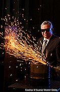 (2011GLOBE100) Oxford, MA 050311 IPG Photonics CEO Valentin Gapontsev (cq) photographed at the company's headquarters in front of  a 20,000- watt fiber laser cutting through a 1/2 inch low- carbon steel.   (Essdras M Suarez/ Boston Globe)/ BIZ
