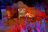 02404 Historic El Tiradito shrine barrio Tucson Arizona cactus colorful night candle legend romance