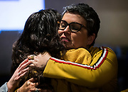 Ananda Mirilli shares an embrace with her daughter Breana during the Madison School Board election watch party at Robinia Courtyard in Madison, Wisconsin, Tuesday, Feb. 19, 2019.