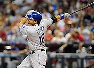 Aug. 6 2011; Phoenix, AZ, USA; Los Angeles Dodgers outfielder Andre Either (16) singles to right during the sixth inning against the Arizona Diamondbacks at Chase Field. The Dodgers defeated the Diamondbacks 5-3.  Mandatory Credit: Jennifer Stewart-US PRESSWIRE..
